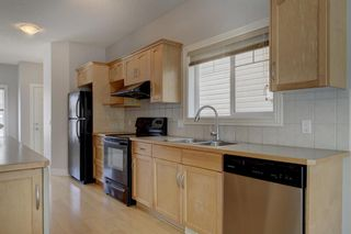 Photo 6: 76 Bridleridge Manor SW in Calgary: Bridlewood Row/Townhouse for sale : MLS®# A1106883