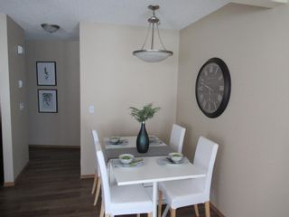 Photo 11: 17 Eversyde Court SW in Calgary: Evergreen Row/Townhouse for sale : MLS®# A1120200