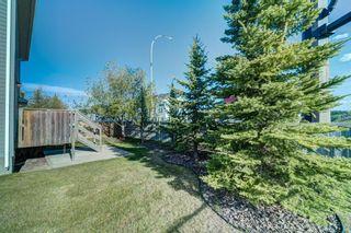 Photo 45: 4 136 Bow Ridge Drive: Cochrane Row/Townhouse for sale : MLS®# A1116097