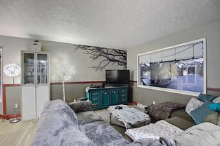 Photo 5: 4 Rossburn Crescent SW in Calgary: Rosscarrock Detached for sale : MLS®# A1073335