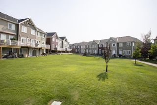 Photo 38: 216 Cascades Pass: Chestermere Row/Townhouse for sale : MLS®# A1133631