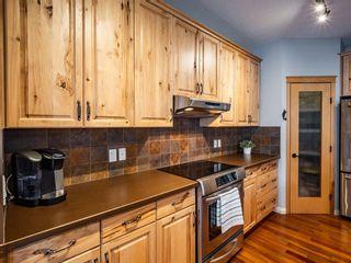 Photo 6: 878 Auburn Bay Boulevard SE in Calgary: Auburn Bay Detached for sale : MLS®# A1077618