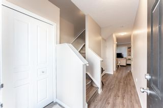 Photo 3: 103 Everridge Gardens SW in Calgary: Evergreen Row/Townhouse for sale : MLS®# A1061680