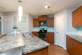 Photo 10: 2427 700 WILLOWBROOK Road NW: Airdrie Apartment for sale : MLS®# A1064770