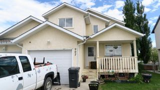 Photo 1: 907 WESTMOUNT Drive: Strathmore Semi Detached for sale : MLS®# A1119443