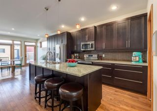 Photo 8: 3322 41 Street SW in Calgary: Glenbrook Detached for sale : MLS®# A1069634