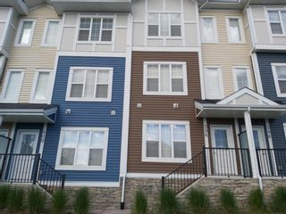 Photo 2: 398 Nolancrest Heights NW in Calgary: Nolan Hill Row/Townhouse for sale : MLS®# A1042890