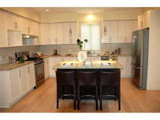 Photo 7: 3686 E GEORGIA ST in Vancouver: Renfrew VE House for sale (Vancouver East)  : MLS®# V1040327