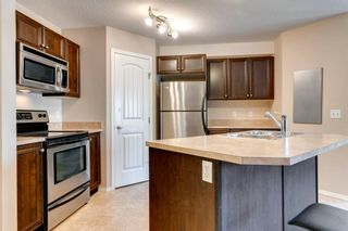 Photo 11: 104 20 Panatella Landing NW in Calgary: Panorama Hills Row/Townhouse for sale : MLS®# A1117783