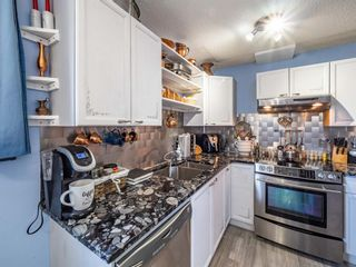 Photo 7: 3910 29A Avenue SE in Calgary: Dover Row/Townhouse for sale : MLS®# A1077291