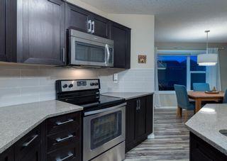Photo 14: 40 EVANSRIDGE Court NW in Calgary: Evanston Row/Townhouse for sale : MLS®# A1095762