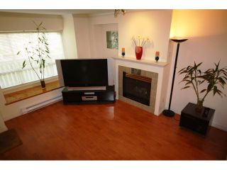 """Photo 3: 102 6588 SOUTHOAKS Crescent in Burnaby: Highgate Townhouse for sale in """"TUDOR GROVE SOUTH"""" (Burnaby South)  : MLS®# V829465"""