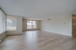 Photo 2: 310 1001 13 Avenue SW in Calgary: Beltline Apartment for sale : MLS®# A1130030