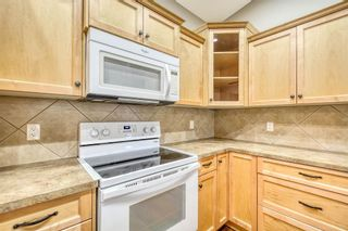 Photo 4: 201 Sunvale Crescent NE: High River Row/Townhouse for sale : MLS®# A1055962