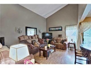 "Photo 3: 7963 138A Street in Surrey: East Newton House for sale in ""BEAR CREEK"" : MLS®# F1405445"