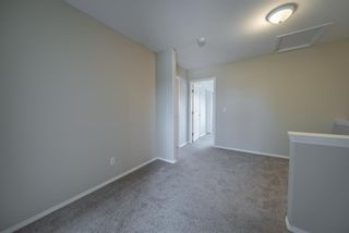 Photo 21: 404 720 Willowbrook Road NW: Airdrie Row/Townhouse for sale : MLS®# A1098346