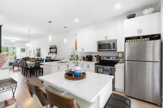 """Photo 1: 702 32789 BURTON Avenue in Mission: Mission BC Townhouse for sale in """"SILVERCREEK TOWNHOMES"""" : MLS®# R2618038"""