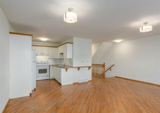 Photo 7: 44 Mt Aberdeen Manor SE in Calgary: McKenzie Lake Row/Townhouse for sale : MLS®# A1078644