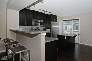 Photo 12: 105 AUBURN BAY Square SE in Calgary: Auburn Bay Row/Townhouse for sale : MLS®# C4278130