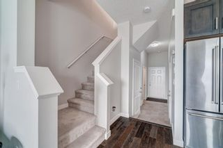 Photo 4: 907 Jumping Pound Common: Cochrane Row/Townhouse for sale : MLS®# A1132952