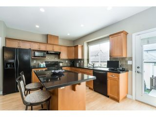 """Photo 8: 7033 179A Street in Surrey: Cloverdale BC Condo for sale in """"Provinceton"""" (Cloverdale)  : MLS®# R2392761"""