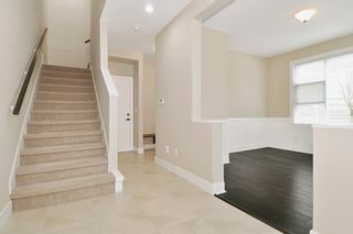 """Photo 2: 23 1299 COAST MERIDIAN Road in Coquitlam: Burke Mountain Townhouse for sale in """"THE BREEZE"""" : MLS®# R2152588"""