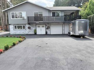 Photo 2: 19994 39A Avenue in Langley: Brookswood Langley House for sale : MLS®# R2596970