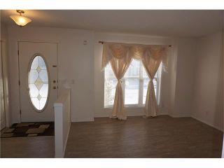 Photo 2: 208 TARINGTON Close NE in Calgary: Taradale House for sale : MLS®# C4040082