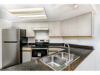 "Photo 6: 410 2925 GLEN Drive in Coquitlam: North Coquitlam Condo for sale in ""GLENBOROUGH"" : MLS®# R2431545"