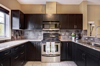 Photo 9: 1503 281 Cougar Ridge Drive SW in Calgary: Cougar Ridge Row/Townhouse for sale : MLS®# A1149149