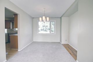 Photo 7: 216 Silver Springs Green NW in Calgary: Silver Springs Detached for sale : MLS®# A1147085