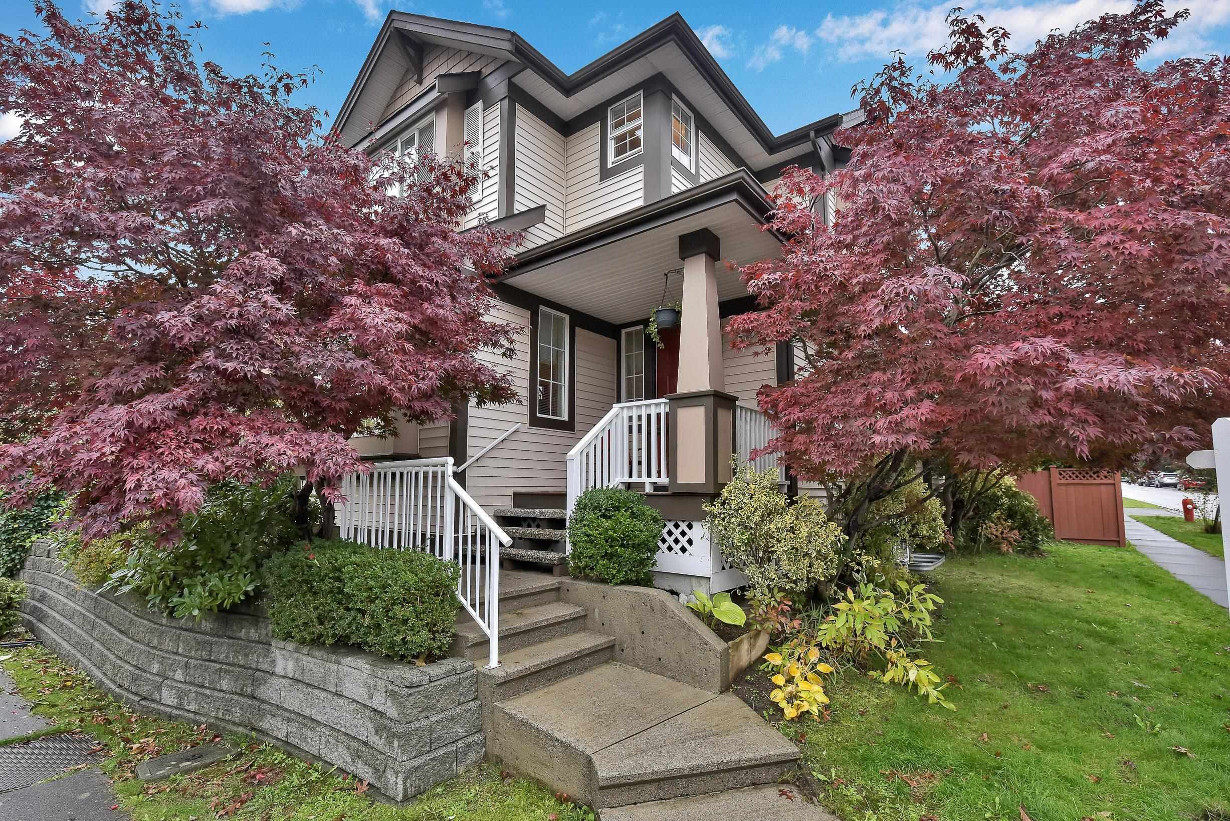 """Main Photo: 18452 67A Avenue in Surrey: Cloverdale BC House for sale in """"Clover Valley Station"""" (Cloverdale)  : MLS®# R2625017"""