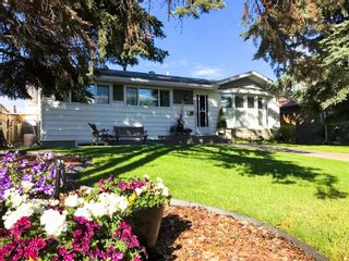Photo 1: 2412 Langriville Drive SW in Calgary: North Glenmore Park Detached for sale : MLS®# A1113209