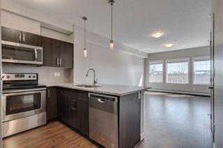 Photo 2: 210 200 Cranfield Common SE in Calgary: Cranston Apartment for sale : MLS®# A1094914