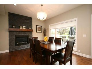 Photo 9: 156 GLENEAGLES Close: Cochrane House for sale : MLS®# C4018066