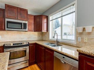 Photo 12: 64 Hidden Green NW in Calgary: Hidden Valley Detached for sale : MLS®# A1058347