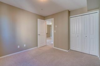 Photo 18: 9302 403 MACKENZIE Way SW: Airdrie Apartment for sale : MLS®# A1032027