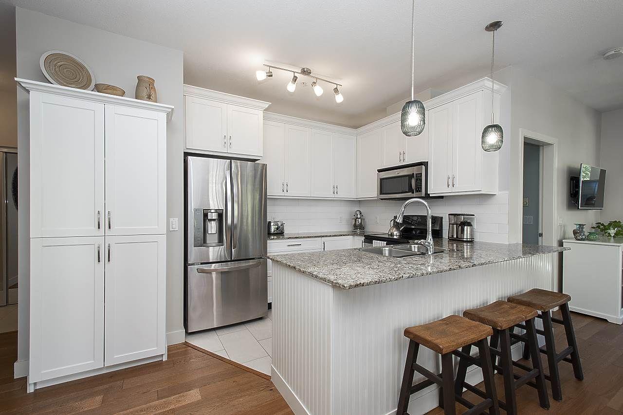 "Main Photo: 206 2484 WILSON Avenue in Port Coquitlam: Central Pt Coquitlam Condo for sale in ""VERDE"" : MLS®# R2509890"