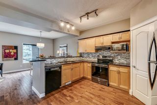 Photo 6: 109 Country Hills Gardens NW in Calgary: Country Hills Semi Detached for sale : MLS®# A1136498