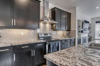 Photo 13: 615 50 Avenue SW in Calgary: Windsor Park Semi Detached for sale : MLS®# A1099934