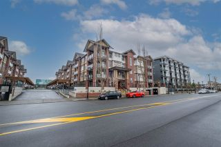 """Photo 1: 409 5650 201A Street in Langley: Langley City Condo for sale in """"Paddington Station"""" : MLS®# R2566139"""