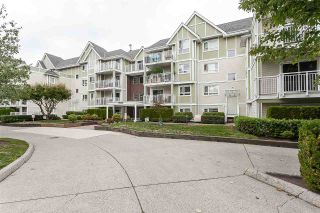 "Photo 1: 205 20189 54 Avenue in Langley: Langley City Condo for sale in ""Catalina Gardens"" : MLS®# R2403720"