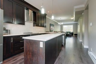 Photo 11: 107 13670 62 Avenue in Surrey: Sullivan Station Townhouse for sale : MLS®# R2597930