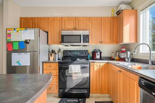 Photo 5: 38 Eversyde Common SW in Calgary: Evergreen Row/Townhouse for sale : MLS®# A1144628
