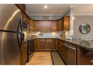 """Photo 8: 401 33338 MAYFAIR Avenue in Abbotsford: Central Abbotsford Condo for sale in """"THE STERLING"""" : MLS®# R2617623"""