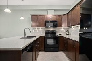 Photo 4: 226 1 Crystal Green Lane: Okotoks Apartment for sale : MLS®# A1146254
