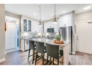 """Photo 8: 105 16380 64 Avenue in Surrey: Cloverdale BC Condo for sale in """"The Ridgse and Bose Farms"""" (Cloverdale)  : MLS®# R2556734"""