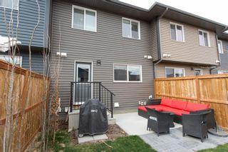 Photo 26: 179 Fireside Way: Cochrane Row/Townhouse for sale : MLS®# A1109604