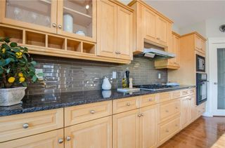 Photo 15: 152 STRATHLEA Place SW in Calgary: Strathcona Park House for sale : MLS®# C4130863