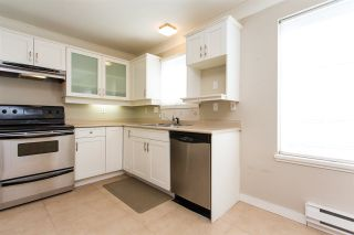 """Photo 1: 408 5465 201 Street in Langley: Langley City Condo for sale in """"Briarwood Park"""" : MLS®# R2393279"""